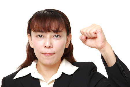 Asian businesswoman in a victory pose