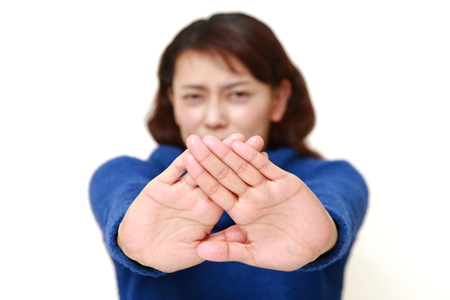 Asian woman making stop gesture