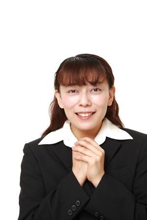 pleased: Asian businesswoman pleased