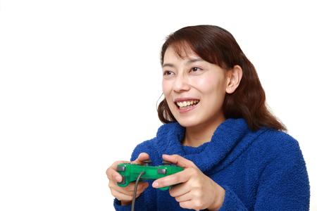 Asian woman enjoying a video game