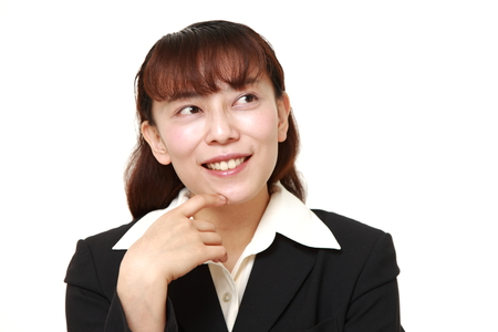 unattractive: Asian businesswoman dreaming at her future