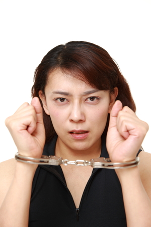 arrested: arrested woman Stock Photo