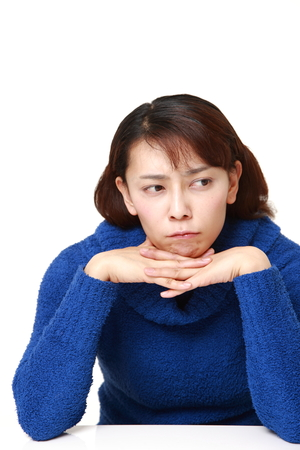 unattractive: Asian woman worries about something