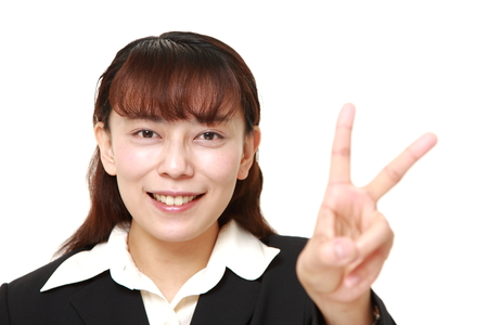 Asian Businesswoman showing a victory sign