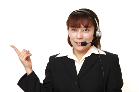 unattractive: Asian businesswoman of call center with head sets presenting Stock Photo