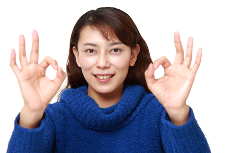 perfect sign: Asian woman showing perfect sign