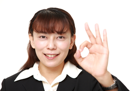 Asian woman showing perfect sign