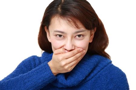 アジアの女性の whith 沈黙ジェスチャー 写真素材