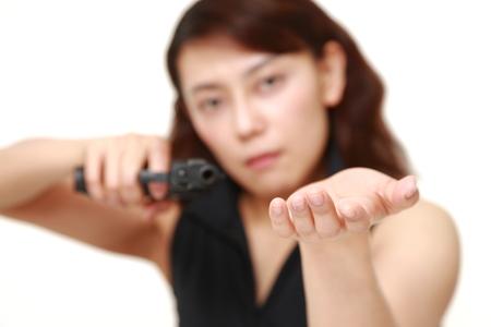 female robber with a handgun Stock Photo