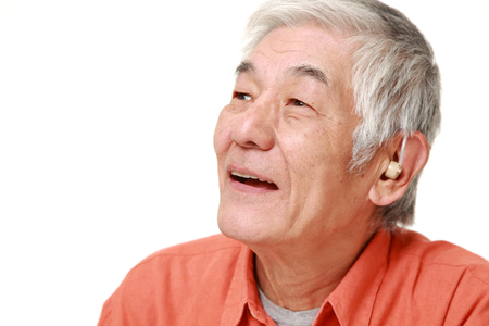 senior Japanese man with hearing aid