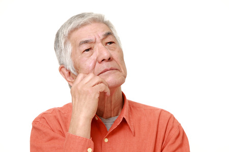 senior Japanese man worries about something Stock Photo