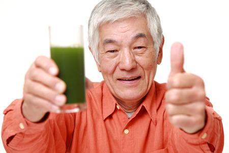 70s: senior Japanese man with green vegetable juice