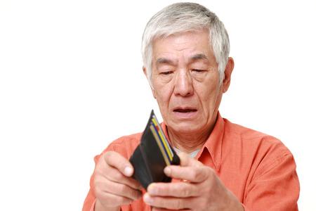 poor senior Japanese man Stock Photo
