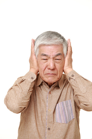 senior Japanese man suffers from noise