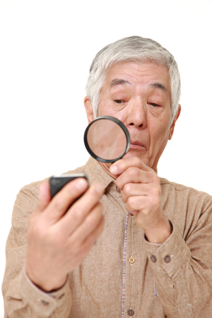 senior Japanese man with presbyopia