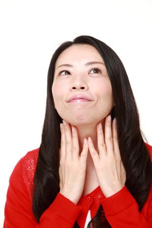 lymph: Japanese woman doing a self lymph node massage?