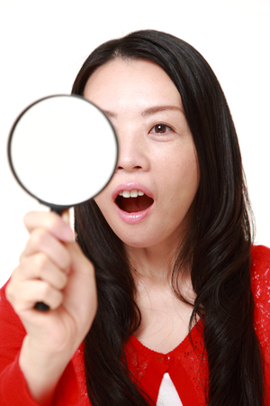 forties: Japanese woman with a magnifying glass