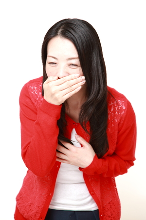 vomiting: Japanese woman feels like vomiting
