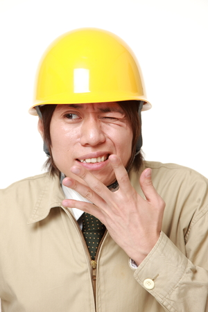 perplexed: perplexed construction worker Stock Photo