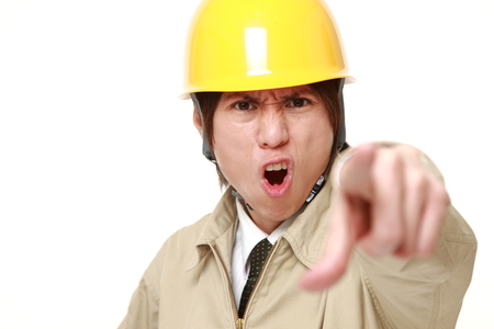 denunciation: young Japanese construction worker scolding  ? Stock Photo