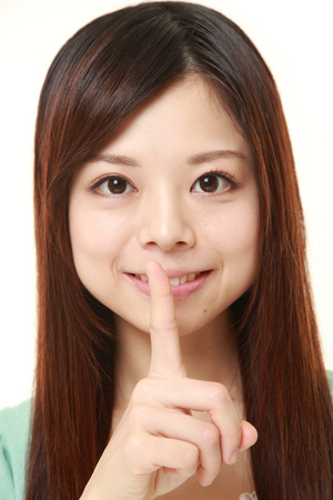 young Japanese woman whith silence gestures