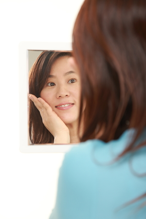 satisfactory: middle aged Japanese woman with good condition skin