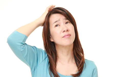 middle aged Japanese woman perplexed