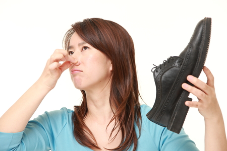 bad smell: middle aged Japanese woman holding her nose because of a bad smell Stock Photo