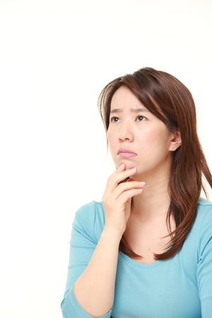 middle aged Japanese woman worries about something Stock Photo