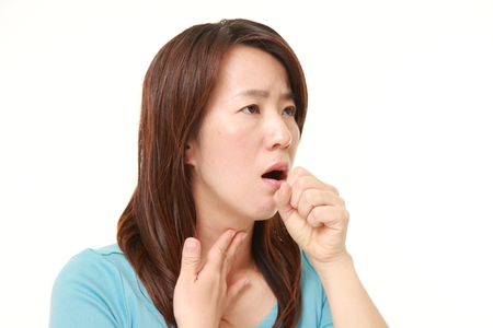 Middle aged Japanese woman coughing?