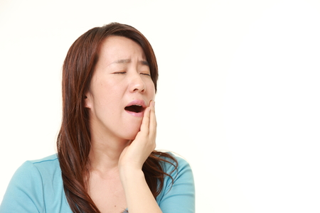 middle aged Japanese woman with toothache
