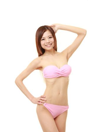 tempt: Japanese woman posing in a pink bikini