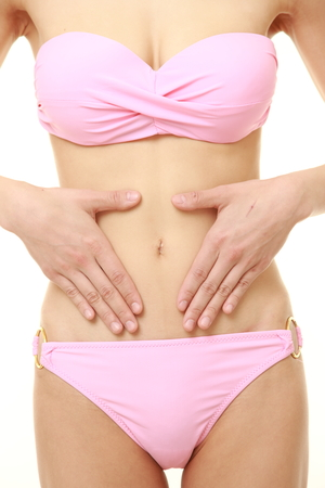 digesting: Woman with hands over belly Stock Photo
