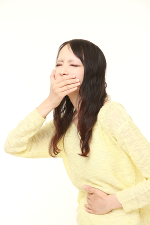 vomiting: young Japanese woman feels like vomiting Stock Photo