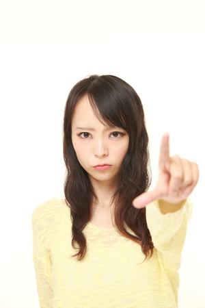 denunciation: young Japanese woman scolding Stock Photo