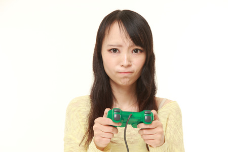 wimp: young Japanese woman losing playing video game