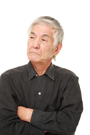 bad mood: senior Japanese man in a bad mood