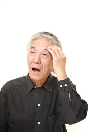 eyestrain: senior Japanese man suffers from headache
