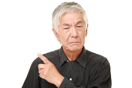 nonchalant: senior Japanese man doubting