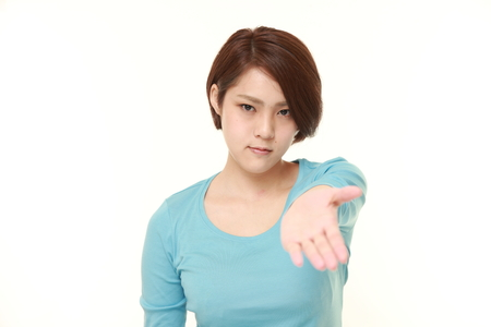 give out: young Japanese woman scolding Stock Photo