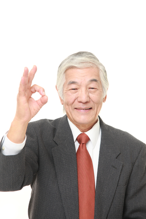 perfect sign: senior Japanese businessman showing perfect sign Stock Photo