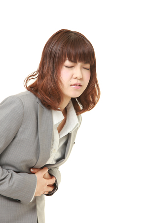defecation: young Japanese businesswoman suffers from stomachache?