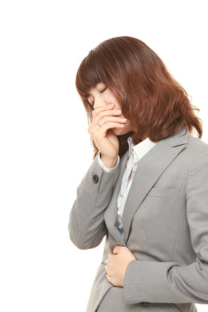 vómito: young Japanese businesswoman feels like vomiting