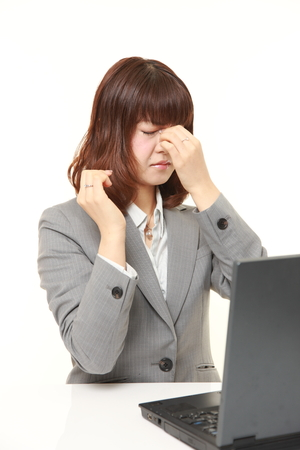 young Japanese businesswoman suffers from Asthenopia Stock fotó
