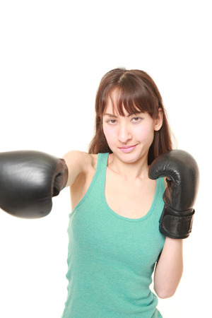 female boxer: female boxer throws a right straight