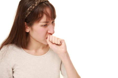 coughing: young woman coughing?