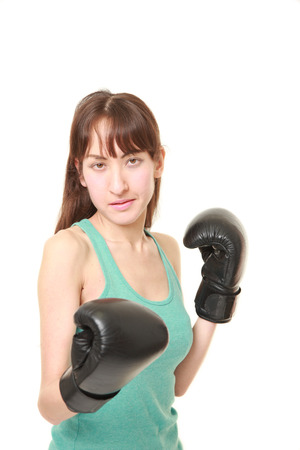 female boxer: female boxer with punching glovesthrows on a fight position