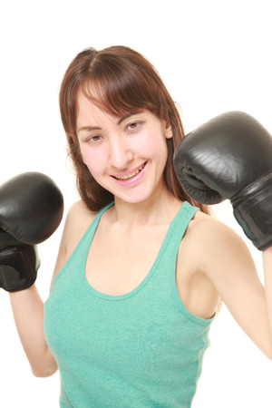 female boxer: female boxer with punching glovesthrows in a victory pose