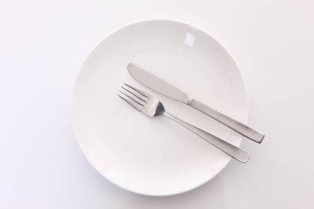 white dish on the white table with cutlery meaning FINISHED
