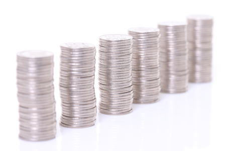 stacked Japanese 100 yen coins lined up Stock Photo